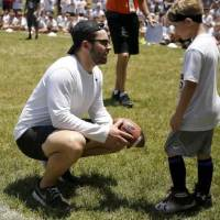 Baker Mayfield talks with Maddex Travis during the Baker Mayfield Football ProCamp in Norman, Okla., Wednesday, June 19, 2019. [Bryan Terry/The...