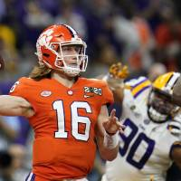 Clemson quarterback Trevor Lawrence passes against LSU during the first half of a NCAA College Football Playoff national championship game Monday,...