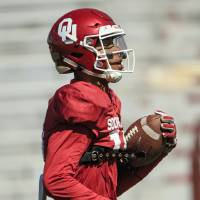 Receiver Theo Wease (10) runs with the ball during the University of Oklahoma spring football practice at the Gaylord Family Oklahoma Memorial...