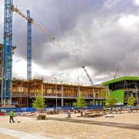 Crews continue work on the Omni Hotel and the new convention center as seen from the north lawn of Scissortail Park.  [Chris Landsberger/The...