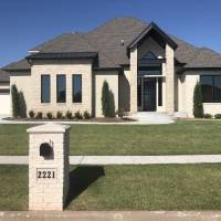 John Nail Homes & Development built this transitional-contemporary style home at 2221 War Eagle Lane in Yukon. The 2,950-square-foot home,...