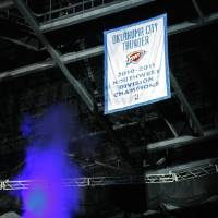 Photo - A Northwest Division Champions banner  is unvield before the NBA basketball game between the Oklahoma City Thunder and the Milwaukee Bucks at the Oklahoma City Arena, Wednesday, April 13, 2011. Photo by Bryan Terry, The Oklahoman