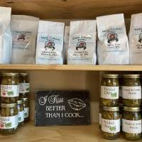 Home-canned pickles and gluten-free mixes are among the items lining the shelves at the Arcadia Farmers Market General Store. [KIMBERLY BURK]
