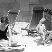 Amelia Earhart, the Trans-Atlantic flyer, and her Stepson, Dave Putman, photographed on the beach on July 9, 1932 at Los Angeles, California, a...