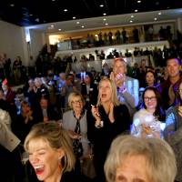 A crowd cheers as Oklahoma City Mayor David Holt announces that MAPS 4 has passed during a watch party for MAPS 4 inside the Yale Theater in...