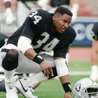 Former Heisman Trophy winner Bo Jackson, shown stretching along the sidelines with his Los Angeles Raiders teammates in 1987, had a memorable...