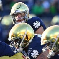 Quarterback Ian Book (top) and the Fighting Irish will forgo independence this season to play in the ACC. [Matt Cashore/USA TODAY Sports]