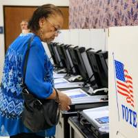 Anita Arnold cast her ballot during early voting period Nov. 1 at the Oklahoma County Election Board in Oklahoma City. [Chris Landsberger/The...