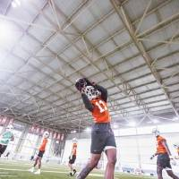 Dee Anderson catches a pass during Oklahoma State football practice on Thursday. [Bruce Waterfield/Courtesy of OSU Athletics]