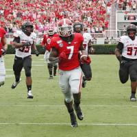Georgia Bulldogs running back D'Andre Swift (7) scores on a pass play which he broke for a touchdown during the first half of todays Georgia vs...
