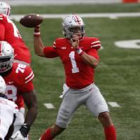 Ohio State quarterback Justin Fields throws a pass against Nebraska during the first half of an NCAA college football game Saturday, Oct. 24, 2020,...