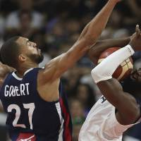 France's Rudy Gobert blocks United States' Jaylen Brown during a quarterfinal match for the FIBA Basketball World Cup in Dongguan in southern...