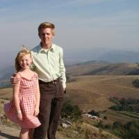 Barry Schmelzenbach and his daughter, Vien, are shown in Endingeni, Swaziland (currently Eswatini), where his great-grandfather, Haroman F....