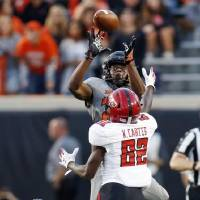 Oklahoma State's Jarrick Bernard, rear, has started every game of his college career since coming to OSU as a true freshman in 2018. [NATE...