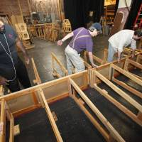 "Photo - Pollard Theatre Artistic Director Jerome Stevenson, Lance Reese and Timothy Steward work on the set for the ""A Territorial Christmas Carol"" production that opens after Thanksgiving in Guthrie.  Photo By David McDaniel, The Oklahoman"