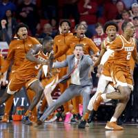 Texas's Matt Coleman III (2) celebrates his go-ahead 3-point basket in the final seconds during the men's basketball game between Oklahoma and...