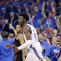 Oklahoma City's Jerami Grant (9) celebrates a 3-point basket in front of Portland's CJ McCollum (3) during Game 4 in the first round of the NBA...
