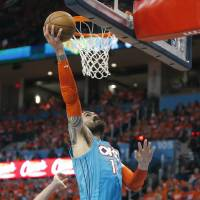 Oklahoma City's Steven Adams (12) goes to the basket during Game 3 in the first round of the NBA playoffs between the Portland Trail Blazers and...
