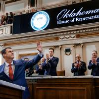 Gov. Kevin Stitt waves to the gallery as he begins his State of the State Address in the House Chambers of the Oklahoma House of Representative in...