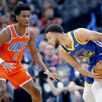Golden State's Stephen Curry, right, tries to get past Oklahoma City's Shai Gilgeous-Alexander during an Oct. 27 game at Chesapeake Energy Arena....
