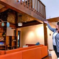 Kirsten McIntyre, an agent with Keller Williams Realty Central Oklahoma, points out features in the living room of a home she has listed for sale...