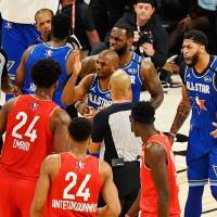 Team LeBron guard Chris Paul of the Oklahoma City Thunder, front, forward LeBron James of the Los Angeles Lakers, back, and forward Anthony Davis...