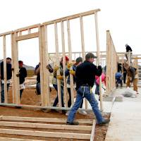 People raise a frame on a build of the 1000 Central Oklahoma Habitat for Humanity in the Legacy Estates addition in Oklahoma City, Saturday, Dec....