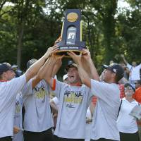Oklahoma State, including Zach Bauchou, left, Austin Eckroat, center, and Matthew Wolff, celebrate with the trophy after winning the NCAA Men's...