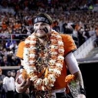 Oklahoma State's Dru Brown wears a Hawaiian lei for his Senior Night introduction last week at Boone Picken Stadium in Stillwater. [Sarah...