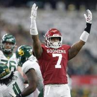 Oklahoma's Ronnie Perkins (7) celebrates after a stop against Baylor in a 30-23 overtime win Saturday. [Bryan Terry/The Oklahoman]