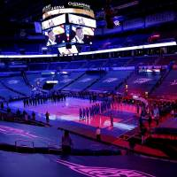 Players stand for the national anthem before the NBA game between the Oklahoma City Thunder and Utah Jazz at the Chesapeake Energy Arena in...
