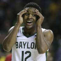 Baylor guard Jared Butler reacts to a score against West Virginia in the first half of an NCAA college basketball game, Saturday, Feb. 15, 2020, in...