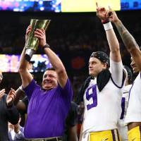 CFP executive director Bill Hancock (left) says playoff committee members still can discern quality, even in a fractured season. LSU passed the...