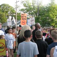 Photo - Protesters gathered outside of Harrah Middle School on Thursday. The rally was the result of bullying claims from a teen at Harrah schools, but the protests prompted various activists and families from in and around the area to attend. Photos by Vallery Brown, THE OKLAHOMAN