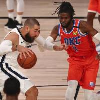 Grizzlies center Jonas Valanciunas, left, drives into the paint againstThunder center Nerlens Noel (9) during the second half Friday. Valanciunas...