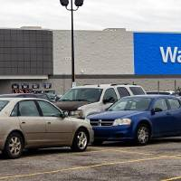 Cars sit in the parking lot at the Walmart location in Yukon, Okla. on Monday, April 13, 2020.  [Chris Landsberger/The Oklahoman Archives]
