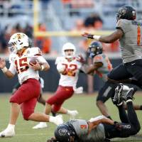 Iowa State quarterback Brock Purdy (15) ran for 38 yards and a touchdown Saturday, but this time he didn't leave Stillwater with a win. [Sarah...