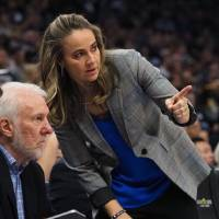 Becky Hammon, talking with San Antonio head coach Gregg Popovich during a game in Sacramento this past season, has been a Spurs assistant since...