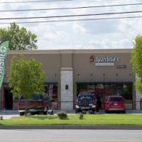 Green Light District Cannabis Supply is on one end, and Herban Mother Cannabis Dispensary is on the other end of this small, four-bay retail strip...