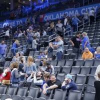 Oklahoma City Thunder fans leave after an NBA basketball game between the Oklahoma City Thunder and the Utah Jazz was postponed at Chesapeake...