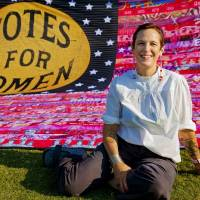 """Oklahoma artist Marilyn Artus poses for a photo with her completed multi-year """"Her Flag"""" project commemorating the 100th anniversary of th 19th..."""