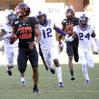 Oklahoma State's Chuba Hubbard (30) rushes for a 92-yard touchdown in the third quarter during the college football game between the Oklahoma State...