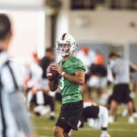 Oklahoma State quarterback Spencer Sanders prepares to throw as condensation builds on the inside of his face shield during OSU's first practice...