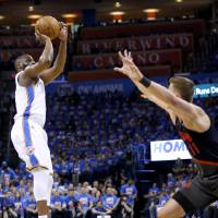 Oklahoma City's Raymond Felton (2) shoots a 3-point basket over Portland's Meyers Leonard (11) during Game 4 in the first round of the NBA playoffs...