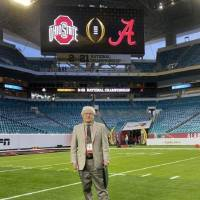 Longtime Norman resident David Gore worked the game clock during Monday's national championship game. He spent decades as an on-field official,...