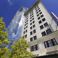 The Colcord Hotel, on the northwest corner of Sheridan and Robinson, with the Devon Energy Tower in background.  Devon Energy confirmed Friday the...