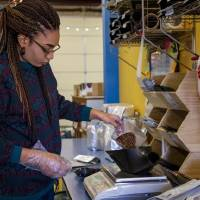 Jasmine Jones weighs out a batch of coffee beans to be packaged at LEAP Coffee Roasters on Monday, Jan. 27, 2020, in Oklahoma City, Okla.   [Chris...