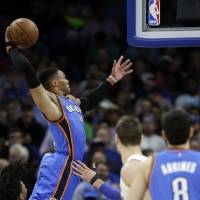 Oklahoma City's Russell Westbrook dunks the ball against the Orlando Magic during the second half of a game, Wednesday, March 29, 2017, in...