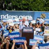 Democratic presidential candidate Sen. Bernie Sanders talks to a crowd during a rally at Reaves Park in Norman, Oklahoma Sept. 22, 2019. [Paxson...