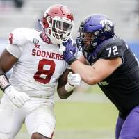 Offensive tackle T.J. Storment (72) and TCU had their hands full blocking OU defensive lineman Perrion Winfrey (8) on Saturday. [AP Photo/Brandon...
